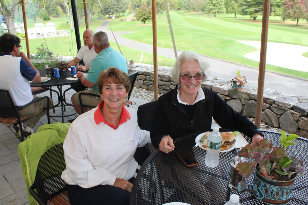 golf attendees at the regional hospice annual golf tournament eating lunch