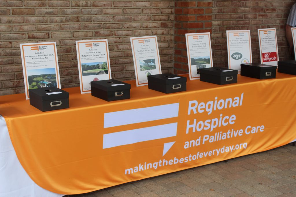 donation table for regional hospice at annual golf tournament
