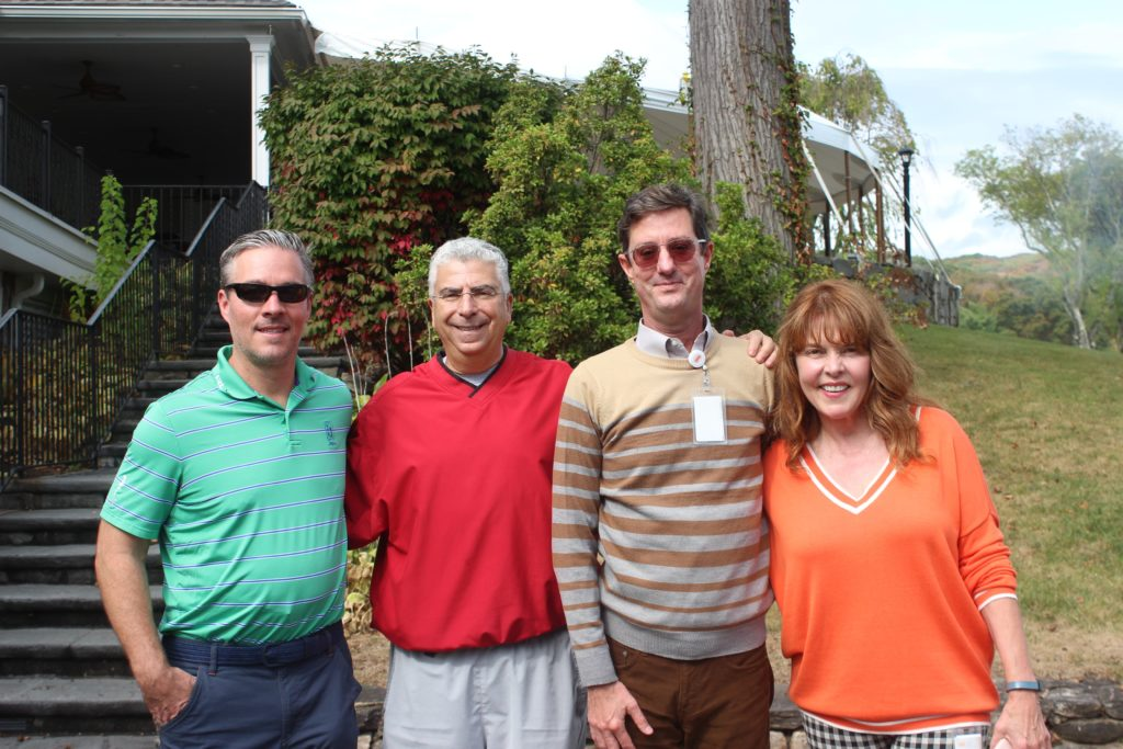 regional hospice employees and donators at annual golf tournament