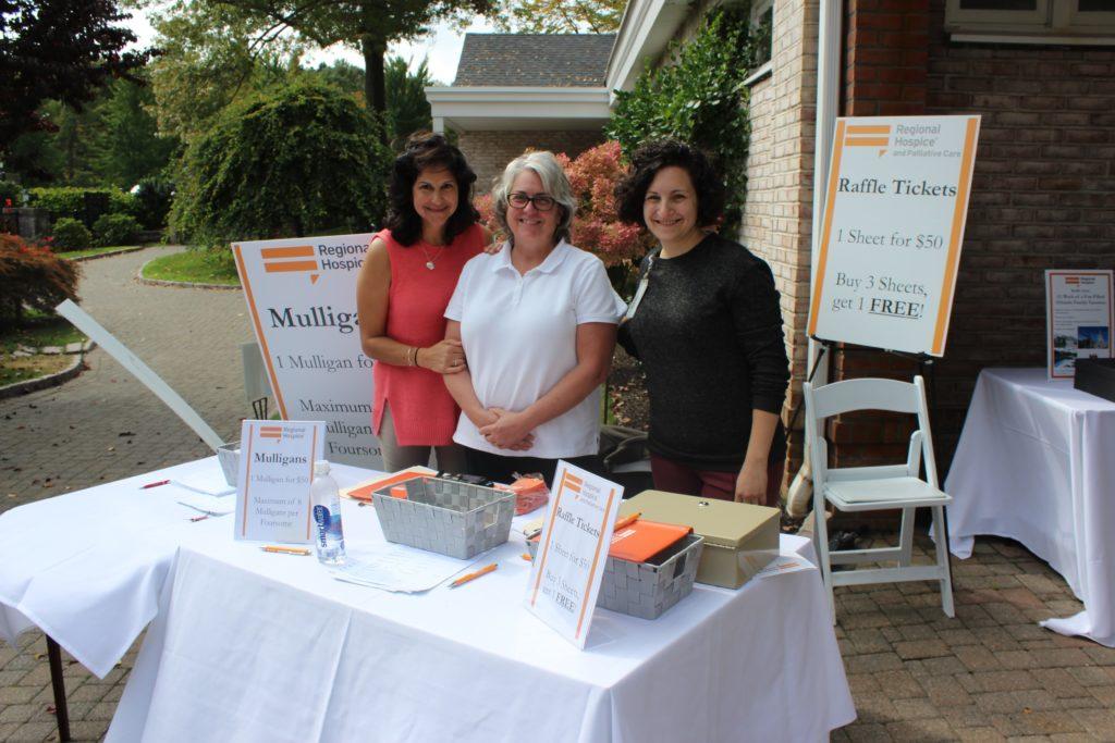 regional hospice volunteers at raffle ticket table