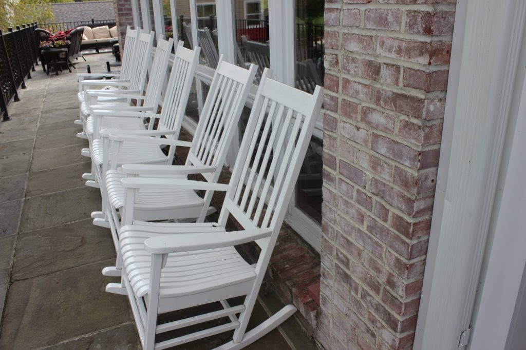 wooden chairs at entrance to ridgewood country club